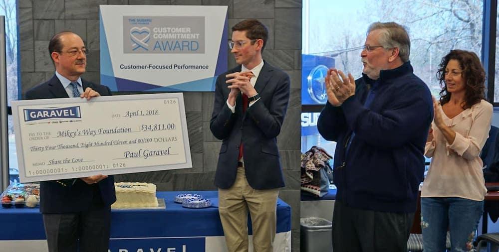Garavel presenting check