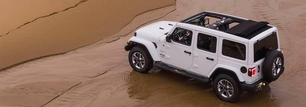 Jeep Wrangler Driving on Sand