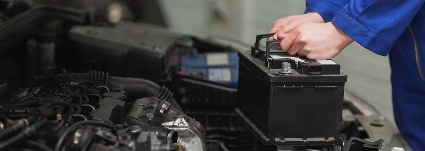 Mechanic Replacing Car Battery