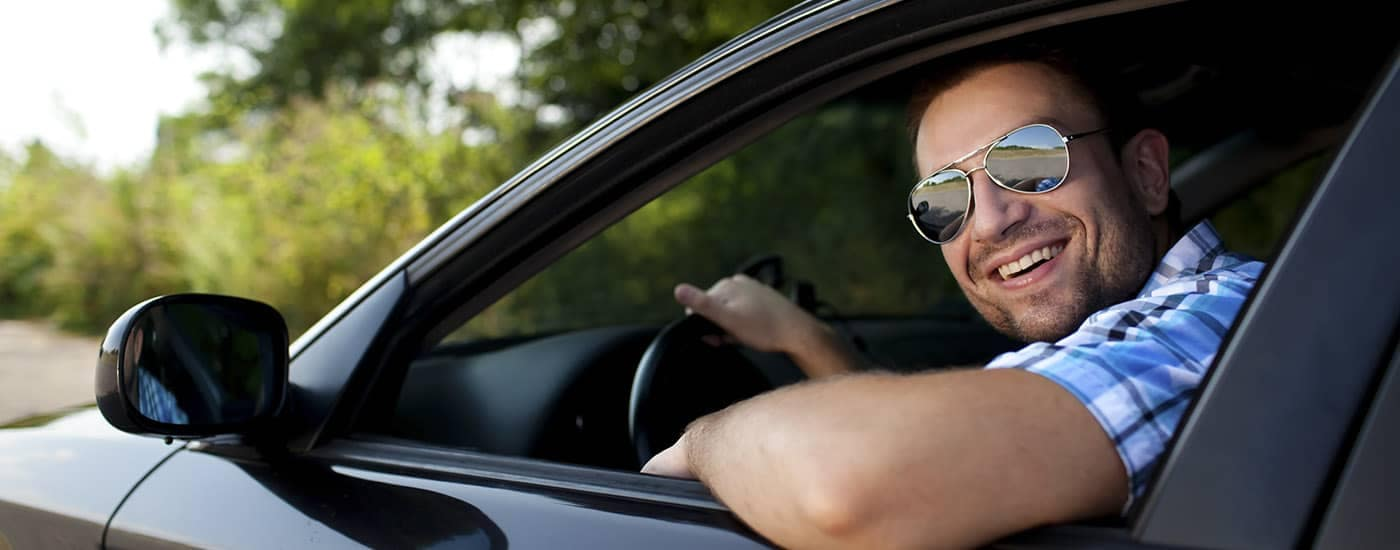 Smiling Man Sitting in Drivers Seat