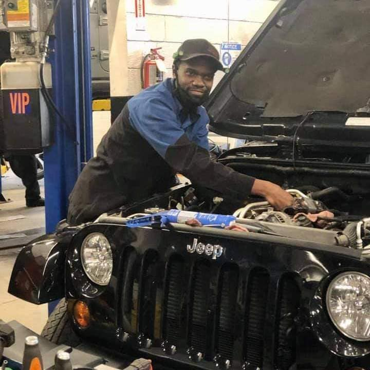 Garavel CDJR Mechanic working on a Jeep