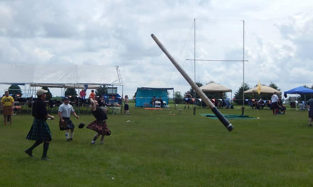 Man Tossing A Caber