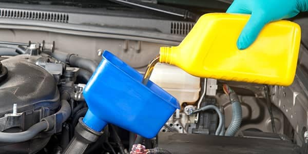 Pouring Oil in Engine