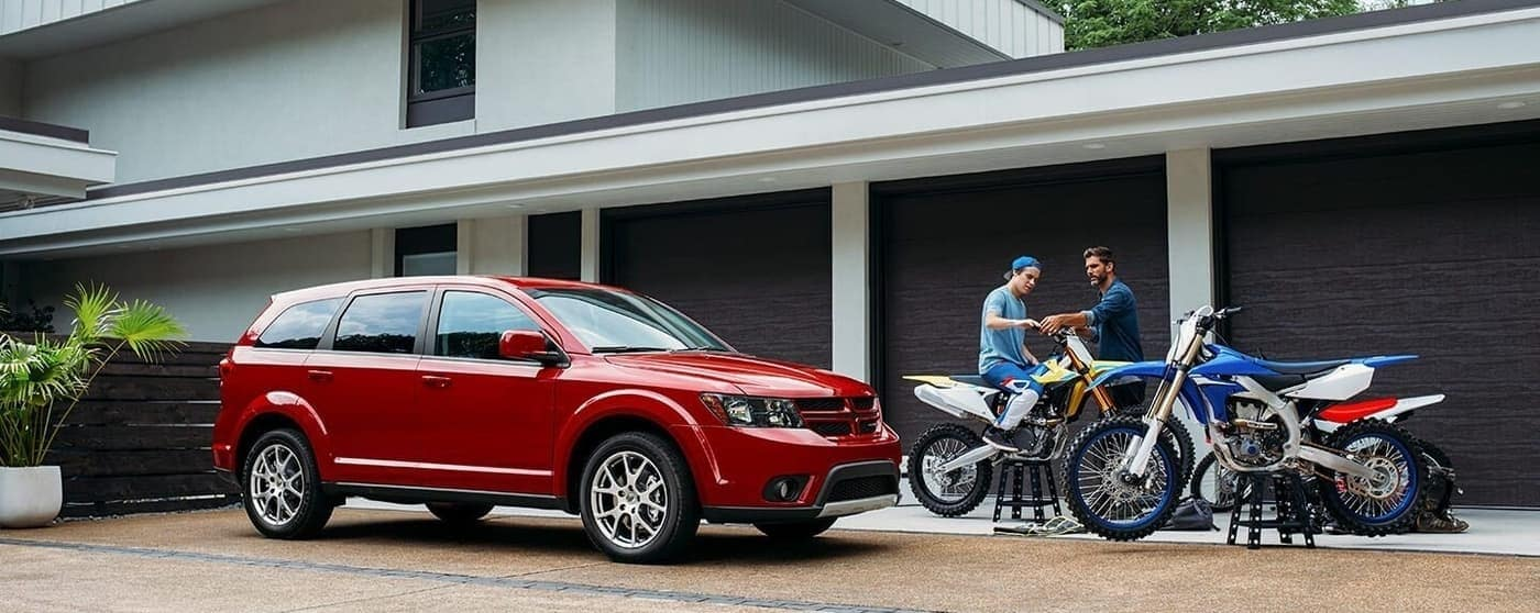 2020 Dodge Journey parked near motorbikes