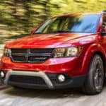 Dodge Journey driving through woods
