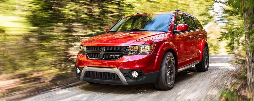 Dodge Journey driving through woods