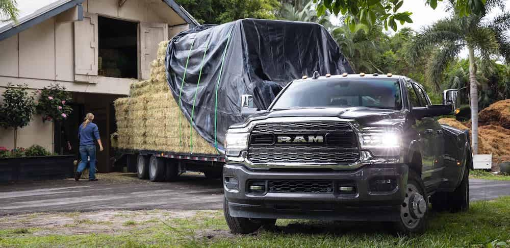 2020 RAM 3500 towing a trailer of hay on farm