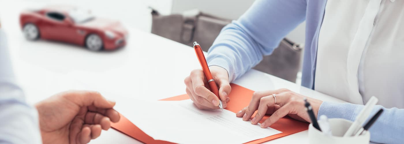 Woman filling out insurance paperwork