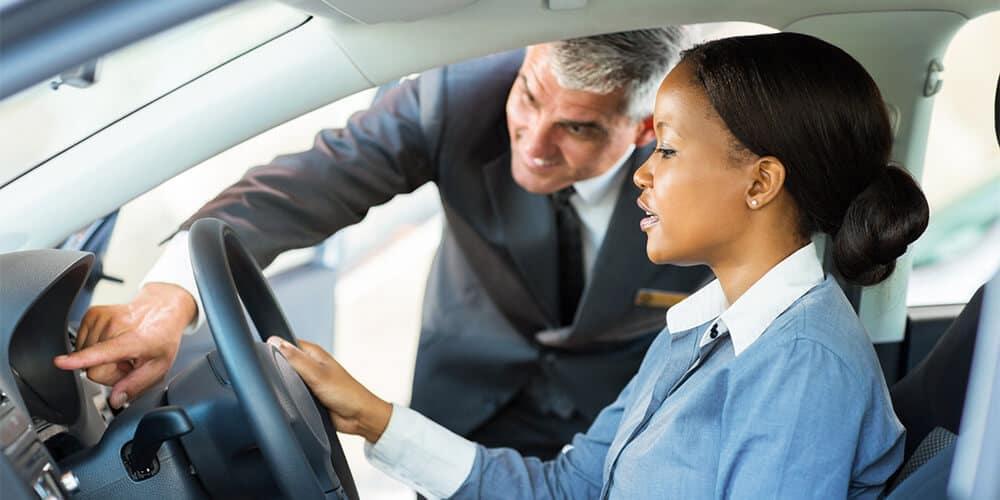 Woman looking at new car