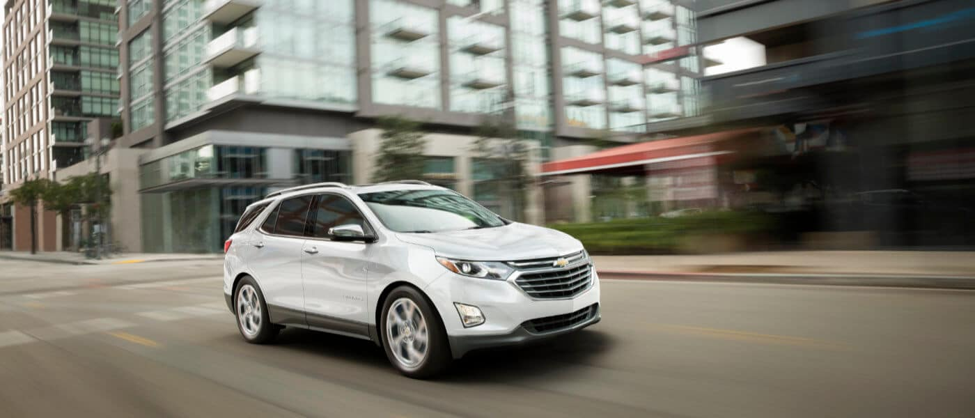 2020 Chevy Equinox driving through town