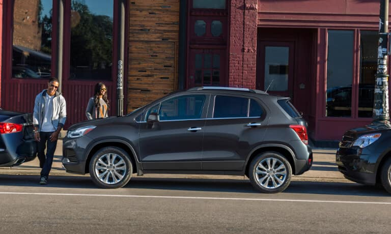 2020 Chevrolet Trax parallel parked with young couple