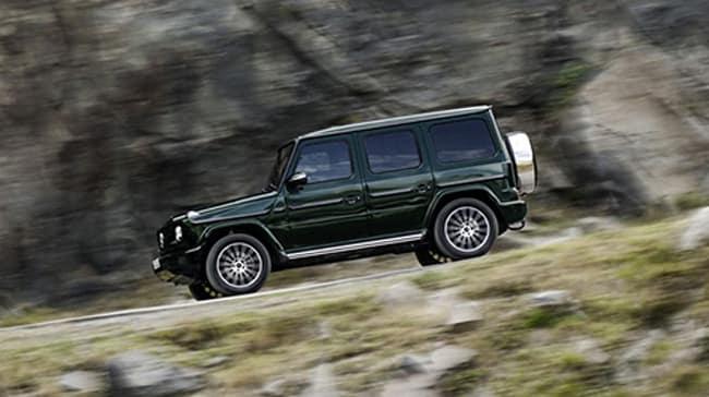 g class driving down rocky terrain