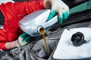 Pouring Synthetic Oil into a Car