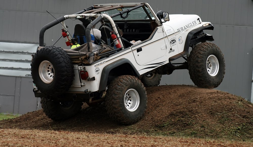Jeep Jumping a Hill
