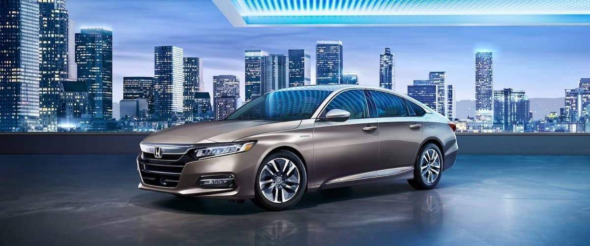 2019 Honda Accord with a city in the background