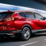 Radiant Red Metallic 2020 CR-V taking a turn