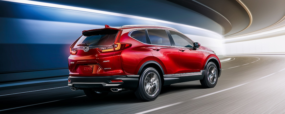 Radiant Red Metallic 2020 CR-V taking a turn
