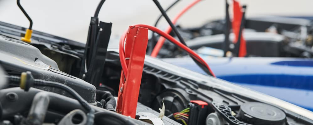Jumper Cables on a Battery