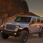 2021 Jeep Wrangler 4xe driving on a dirt road
