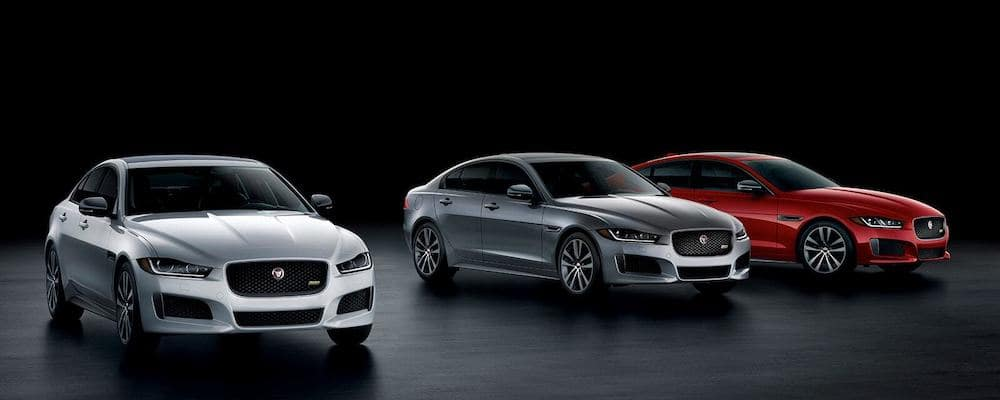 2019 Jaguar XE lineup with one silver one gray and one red sedan