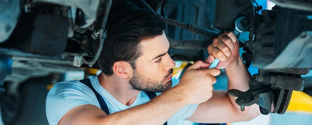 Auto mechanic doing maintenance on car