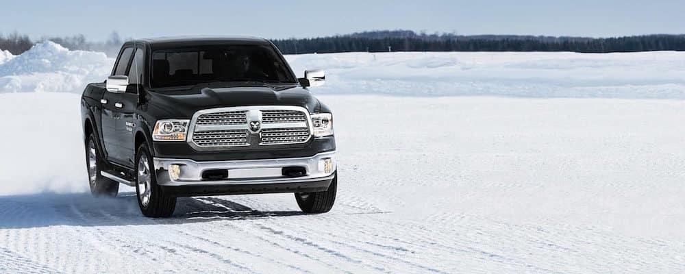 RAM Truck parked in snowy landscape