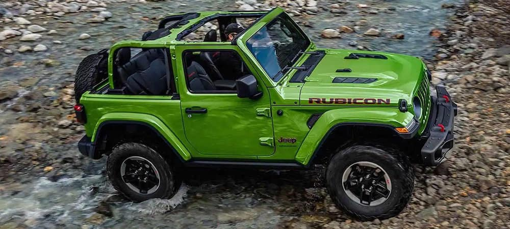 Green 2019 Jeep Wrangler Rubicon crossing stream