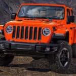 Orange Jeep Wrangler off-roading