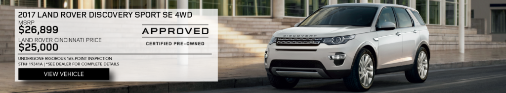 White 2017 Land Rover Discovery Sport SE 4WD on road in front of building. MSRP $26,899. Land Rover Cincinnati Price $25,000. Undergone rigorous 165-point inspection. Stock # 19341A. See dealer for complete details. Click to view Vehicle. Approved certified pre-owned.