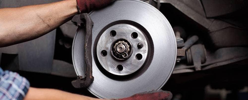 Car mechanic Repairing brakes on car
