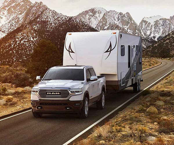 2019 RAM 1500 Towing Camper on road