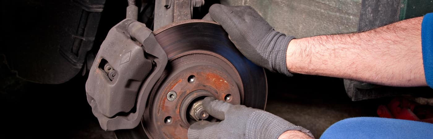 Service technicians hands working on car brakes