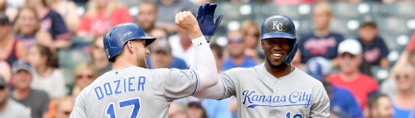 Two Kansas City Royals players smiling and high-fiving