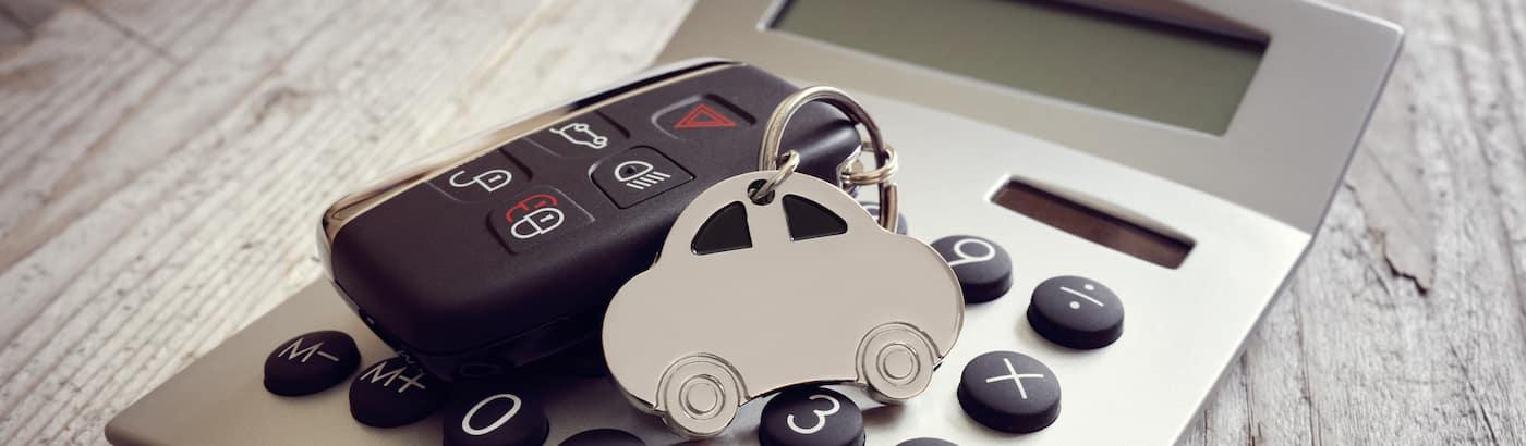 Car key fob resting on calculator