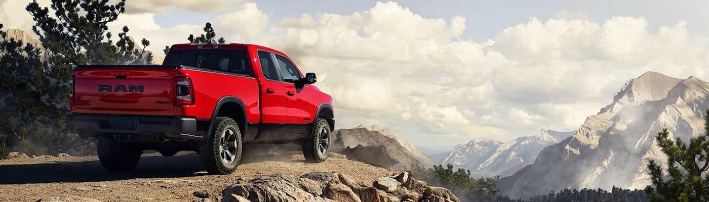 Red RAM 1500 parked overlooking mountains in the distance
