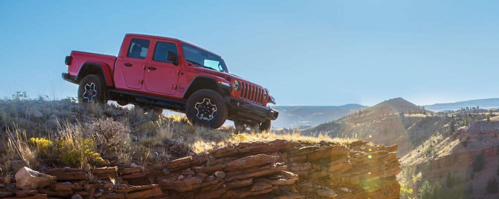 Red Jeep Gladiator parked on edge of cliff