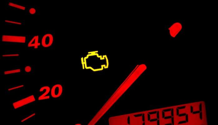 Closeup of check engine light near speedometer
