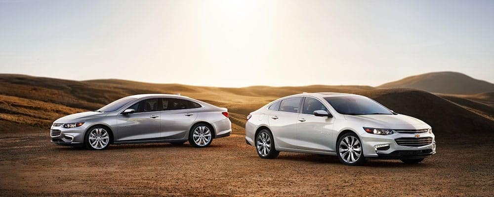 2018 Chevrolet Malibu two cars with sunset