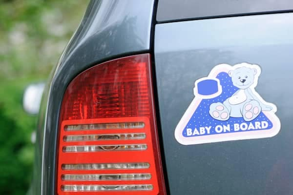 Baby on board sticker on back of car