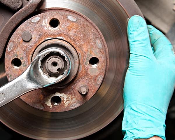 Man repairing a car disc brakes