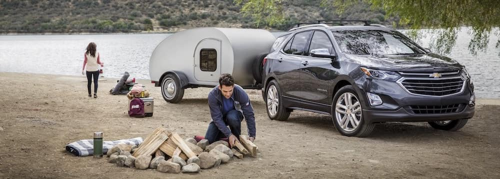 Gray Chevrolet Equinox Parked By A River to Camp