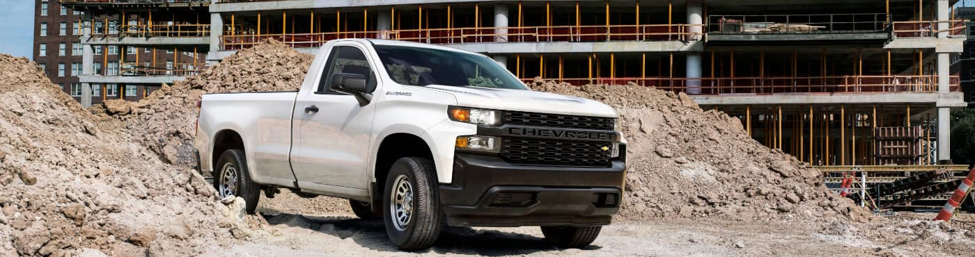 White 2019 Chevrolet Silverado 1500 Parked on A Construction Site