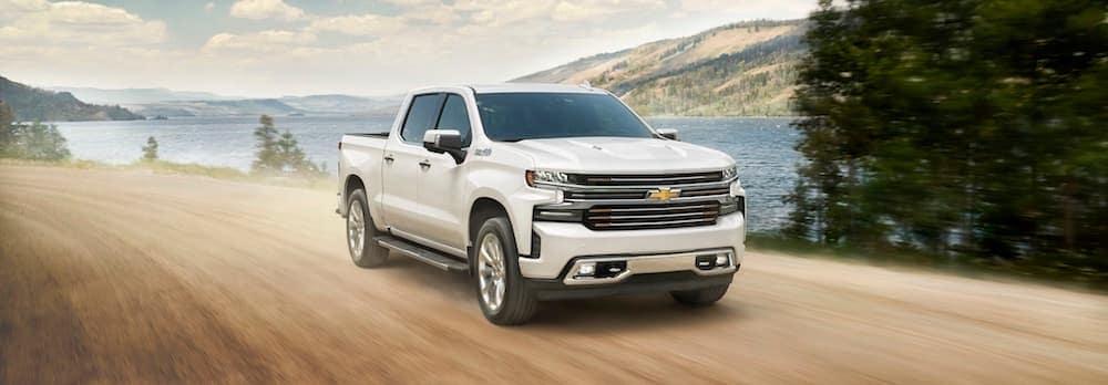 2019 White Chevy Silverado 1500 Driving By A Lake