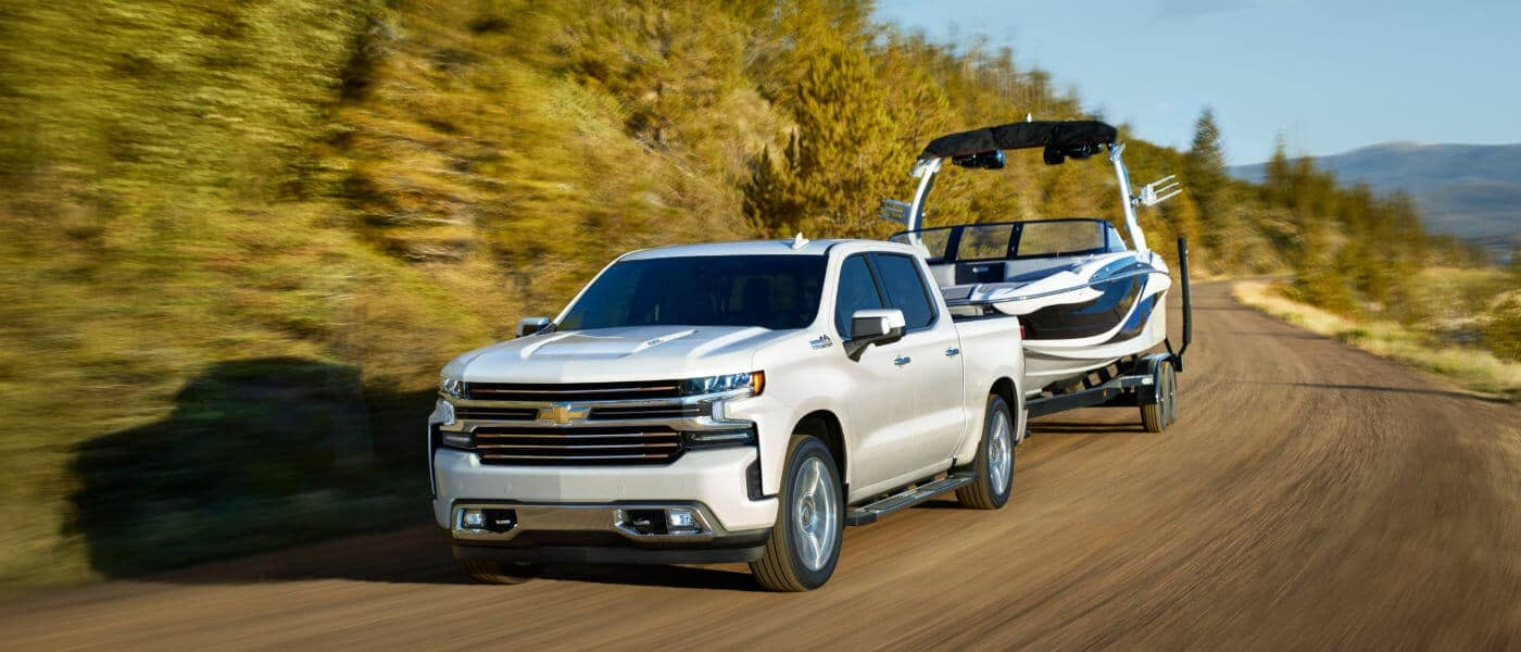 2019 White Chevy Silverado 1500 Towing a Boat