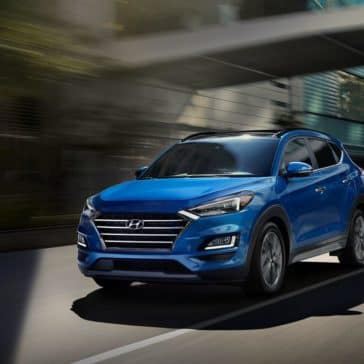 2019-Hyundai-Tucson-driving-down-road
