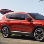 2020 Hyundai Santa Fe with family storing bicycles in trunk
