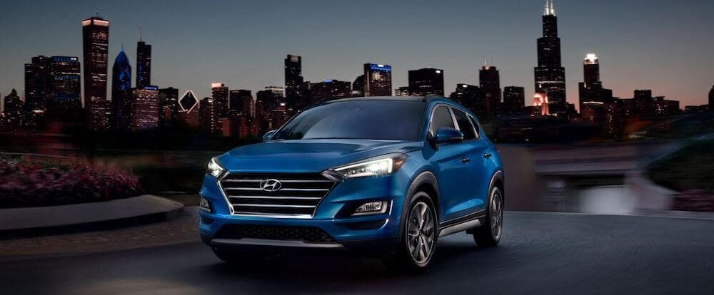 2020 Hyundai Tucson in front of city skyline