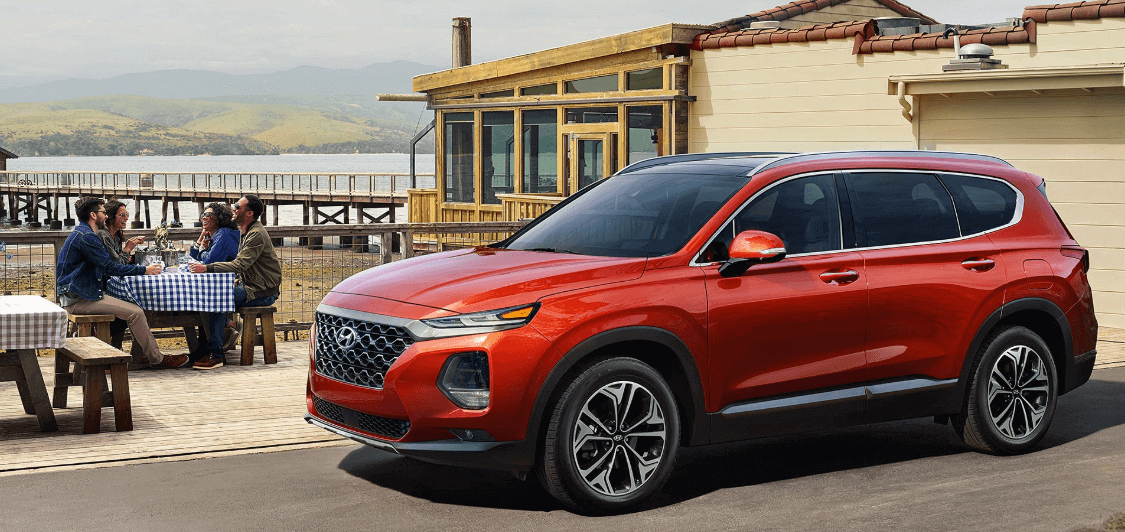 2020 Hyundai Santa Fe parked by lakeside restaurant
