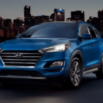2020 Hyundai Tucson parked in front of city skyline