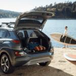 2020 Hyundai Kona with woman taking paddleboard from trunk